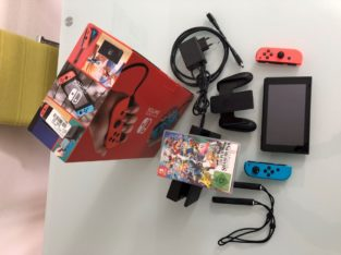 Nintendo Switch + 1 Spiele + Super Smash Bros Ultimate